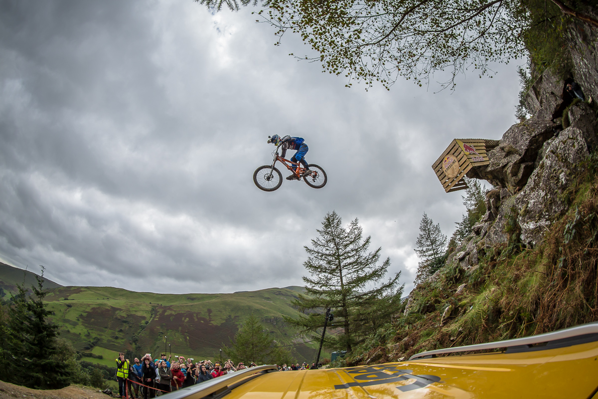 rider jumps over a jeep on the cannon jump at the redbull hardline
