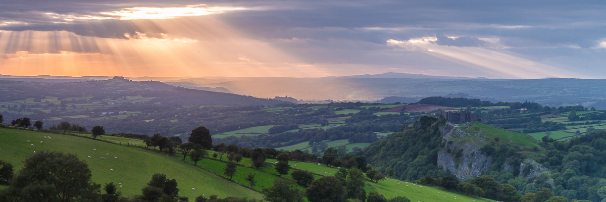 Crepuscular rays over Carreg Cennen Castle in the Brecon beacons