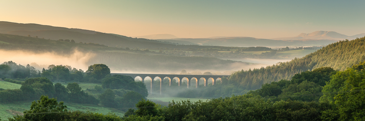 Cynghordy Viaduct with the Brecon Beacons in the background